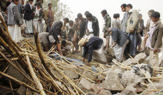 In this Saturday, April 4, 2015, file photo, Yemenis search for survivors in the rubble of houses destroyed by Saudi-led airstrikes in a village near Sanaa, Yemen. (AP Photo/Hani Mohammed, File)