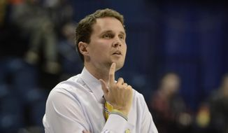 In this Dec. 18, 2014, photo, University of Tennessee at Chattanooga basketball coach Will Wade watches during a college basketball game against Wofford in Chattanooga, Tenn. VCU has hired former Rams assistant Will Wade to replace Shaka Smart as its basketball coach. The 32-year-old Wade was the first assistant Smart hired six years ago. He spent the past two seasons as the head coach at Chattanooga, going 40-25.  (AP Photo/Chatanooga Times Free Press, Logan Foll) THE DAILY CITIZEN OUT (-GADAL); CLEVELAND DAILY BANNER OUT (-TNCLE); NOOGA.COM OUT; LOCAL INTERNET OUT MANDATORY CREDIT