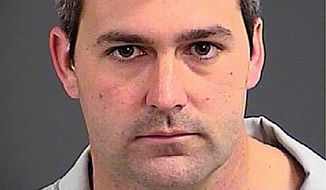South Carolina police officer Michael Thomas Slager was charged with murder Tuesday, hours after law enforcement officials viewed a dramatic video that appears to show him shooting a fleeing man several times in the back. (Associated Press)