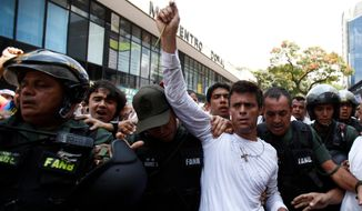 FILE - In this Feb. 18, 2014 file photo, opposition leader Leopoldo Lopez, dressed in white and holding up a flower stem, is taken into custody by Bolivarian National Guards, in Caracas, Venezuela. From Mexico to Brazil, leaders in Latin America have been largely silent in the face of a growing crackdown on dissent in Venezuela and are unlikely to speak out against their neighbor at the upcoming Summit of the Americas on April 10, 2015, in Panama. (AP Photo/Alejandro Cegarra, FIle)