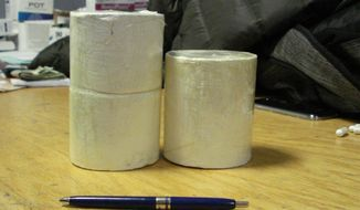 This April 1, 2015 photo provided by U.S. Customs and Border Protection shows cylinders of heroin weighing approximately two pounds in the U.S. Customs and Border Protection office at John F. Kennedy International Airport in New York. CPB agents say they intercepted the heroin as Colombian citizen, Ivan Vidal Forero, tried to smuggle it into the country hidden in his underwear. (AP Photo/U.S. Customs and Border Protection)