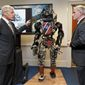 Before leaving office, Defense Secretary Chuck Hagel got a look at high-tech projects being developed by the Defense Advanced Research Projects Agency. Brad Tousley demonstrated a robot that would assist wounded warriors. (Associated Press)