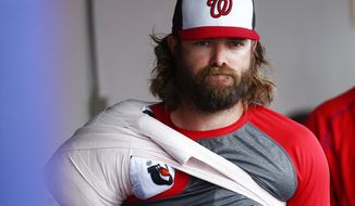 Washington Nationals' Jayson Werth (28) ices his shoulder as he watches an exhibition spring training baseball game against the Houston Astros Friday, March 13, 2015, in Viera, Fla. Werth was not in the starting lineup. (AP Photo/John Bazemore)