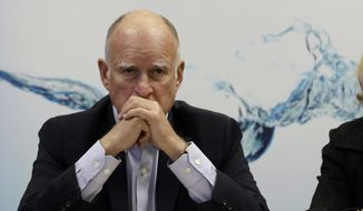 California Gov. Jerry Brown waits for reporters after a three-hour meeting on the drought with agricultural, environmental and urban water agency leaders from across California, Wednesday, April 8, 2015, at his Capitol office in Sacramento. (AP Photo/Rich Pedroncelli)
