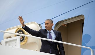 President Barack Obama waves as he boards Air Force One, Wednesday, April 8, 2015 at Andrews Air Force Base, Md. Obama is traveling to Jamaica first before going to Summit of the America meeting in Panama, which begins Friday. (AP Photo/Pablo Martinez Monsivais)