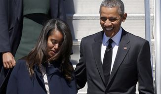In this March 7, 2015, file photo, President Barack Obama and Malia Obama arrive at Air Force One at Maxwell Air Force Base in Montgomery, Ala. (AP Photo/Butch Dill, File)