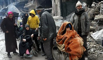 Palestinian residents of the besieged refugee camp of Yarmouk wait at the gate of the camp to receive aid supplies from the United Nations on the southern edge of the Syrian capital, Damascus. The deteriorating situation brought on by Syria's civil war prompted the U.N. Security Council to call an emergency meeting Monday, April 6, 2015, to discuss Yarmouk, calling for safe evacuation for the Palestinians, protection for the refugees, and humanitarian access to the camp. (AP Photo/SANA, File)