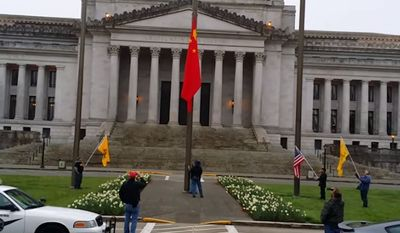 A small group of conservatives gathered at the Washington state capitol on Saturday to protest a Chinese flag that was hoisted up last week in honor of Democratic Gov. Jay Inslee's trade meeting with China's ambassador to the United States. (YouTube/Maria Bosworth)