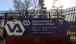 The Fargo VA Medical Center in Fargo, seen Thursday, April 2, 2015, is the main hospital for the North Dakota VA health care system, which includes community-based outpatient clinics in Bismarck, Devils Lake, Dickinson, Grafton, Grand Forks, Jamestown, Minot and Williston. In an analysis of six months of appointment data at 940 VA hospitals and clinics nationwide from September 2014 to February 2015, The VA medical system in North Dakota has managed to keep appointments for most military veterans on a timely schedule, despite the challenge of recruiting doctors to the mostly rural state. (AP Photo/Dave Kolpack)