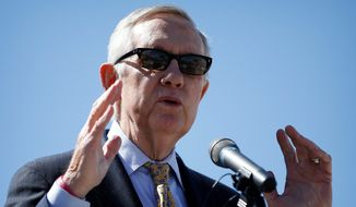 """Retiring Senate Minority Leader Harry Reid, Nevada Democrat, has long opposed a nuclear waste site at Yucca Mountain, said it is """"not something I will ever accept."""""""