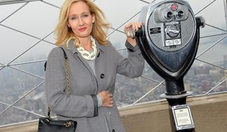 Author J.K. Rowling appears at the Empire State Building observation deck during a lighting ceremony and to mark the launch of her non-profit children's organization Lumos, on Thursday, April 9, 2015, in New York. (Photo by Evan Agostini/Invision/AP)