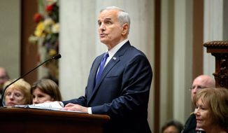 Governor Mark Dayton deliverers  his 2015 State of the State address in the House Chamber of the Minnesota State Capitol, in St. Paul, Minn., Thursday, April 9, 2015. On the right Lt. Gov. Tina Smith.   (AP Photo/The Star Tribune, Glen Stubbe)