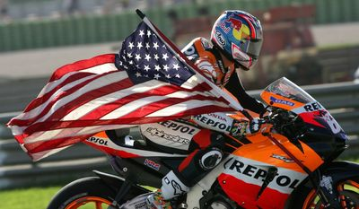 Holding on to Old Glory: US Honda rider Nicky Hayden wins  the world championship. (File photo; AP Photo/Bernat Armangue, File)