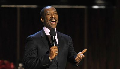"Eddie Murphy addresses speaks at the close of ""Eddie Murphy: One Night Only,"" a celebration of Murphy's career at the Saban Theater in Beverly Hills, Calif., in this Nov. 3, 2012, file photo. (Photo by Chris Pizzello/Invision, File)"