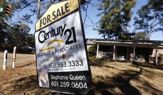 In this Jan. 8, 2015 file photo, a for sale sign is posted in front of a home in Jackson, Miss. (AP Photo/Rogelio V. Solis, File)
