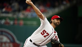 Washington Nationals starting pitcher Tanner Roark (57) throws during the eighth inning of a baseball game against the New York Mets at Nationals Park, Thursday, April 9, 2015, in Washington. The Mets won 6-3. (AP Photo/Alex Brandon)