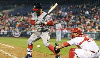 Washington Nationals' Bryce Harper is called for a third strike during the eighth inning of a baseball game against the Philadelphia Phillies, Friday, April 10, 2015, in Philadelphia. The Phillies won 4-1. (AP Photo/Michael Perez)