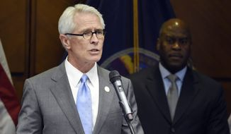 U.S. Attorney Barry Grissom holds news conference on Friday, April 10, 2015 at the Federal Courthouse in Kansas City, Kan.  John T. Booker was charged Friday with attempting to use a weapon of mass destruction, attempting to damage property by means of an explosive and attempting to provide material support to the terrorist group.  Grissom says Booker was arrested Friday near Manhattan, Kan.,  about 100 miles west of Kansas City.  (AP Photo/The Kansas City Star, John Sleezer)