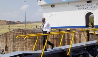 President Barack Obama walks across the Miraflores Locks during his tour of the Panama Canal in Panama City, Panama, Friday, April 10, 2015. Obama is in Panama to attend the VII Summit of the Americas. (AP Photo/Pablo Martinez Monsivais)
