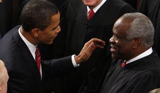 President Barack Obama greets Supreme Court Justice Clarence Thomas prior to his address to a joint session of Congress at the Capitol in Washington, Tuesday, Feb. 24, 2009. (AP Photo/Charles Dharapak)