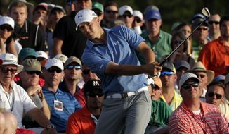 Jordan Spieth hits out of the gallery on the 18th hole during the third round of the Masters golf tournament Saturday, April 11, 2015, in Augusta, Ga. (AP Photo/Chris Carlson)
