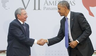 U.S. President Barack Obama and Cuban President Raul Castro shake hands during their meeting at the Summit of the Americas in Panama City, Panama, Saturday, April 11, 2015. (AP Photo/Pablo Martinez Monsivais)