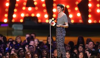 Shailene Woodley accepts the best female performance award at the MTV Movie Awards at the Nokia Theatre on Sunday, April 12, 2015, in Los Angeles. (Photo by Matt Sayles/Invision/AP)