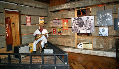 A life-size likeness of legendary blues guitarist Muddy Waters sits inside his cabin that is on display at The Delta Blues Museum in Clarksdale, Mississippi. (Associated Press)