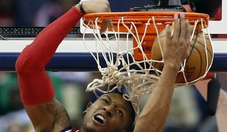 Washington Wizards guard Bradley Beal (3) dunks the ball in the second half of an NBA basketball game against the Atlanta Hawks, Sunday, April 12, 2015, in Washington. The Wizards won 108-99. (AP Photo/Alex Brandon)