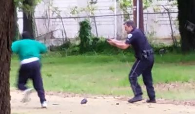 Officer Michael Slager, right, was charged with murder after prosecutors viewed video that appears to show him shooting a fleeing Walter Scott, left, in the back in North Charleston, S.C. (AP Photo/Courtesy of L. Chris Stewart)