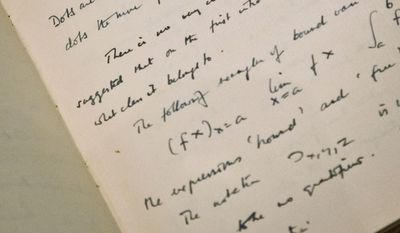 """FILE - This Jan. 22, 2015 file photo, a page from the hand-written notebook by Alan Turing, the World War II code-breaking genius depicted by Benedict Cumberbatch in the Oscar-nominated """"The Imitation Game,"""" is shown at Bonhams auction house in New York. The 56-page manuscript, containing Turing's complex mathematical and computer science notations, is being sold by Bonhams in New York on Monday, April 13. (AP Photo/Bebeto Matthews, File)"""