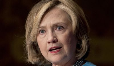 In this Dec. 3, 2014 file photo, former Secretary of State Hillary Rodham Clinton speaks in Gaston Hall at Georgetown University, in Washington. (AP Photo/Carolyn Kaster, File)