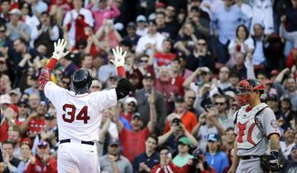 Boston Red Sox designated hitter David Ortiz (34) gestures at the plate after his home run in the sixth inning as Washington Nationals catcher Jose Lobaton watches in the home opener baseball game at Fenway Park in Boston, Monday, April 13, 2015. The Red Sox won 9-4. (AP Photo/Elise Amendola)