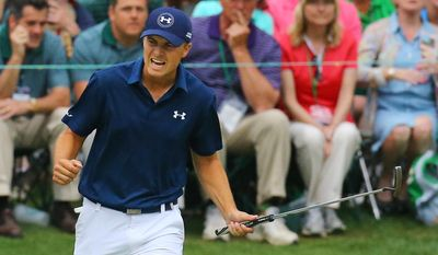 Jordan Spieth reacts to making his par putt on the 16th green closing in on the green jacket winning the Masters at Augusta National Golf Club on Sunday, April 12, 2015, in Augusta, Ga.   (AP Photo/Atlanta Journal-Constitution, Curtis Compton)  MARIETTA DAILY OUT; GWINNETT DAILY POST OUT; LOCAL TELEVISION OUT; WXIA-TV OUT; WGCL-TV OUT