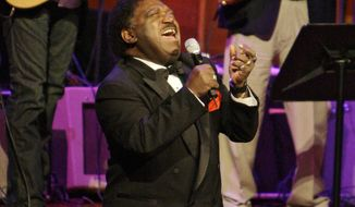 """FILE - In this Oct. 28, 2008 file photo, Percy Sledge kneels as he performs """"When a Man Loves a Woman"""" along with the Muscle Shoals Rhythm Section at the Musicians Hall of Fame awards show in Nashville, Tenn. Sledge, who recorded the classic 1966 soul ballad """"When a Man Loves a Woman,"""" died, Tuesday April 14, 2015. He was 74. (AP Photo/Mark Humphrey, File)"""