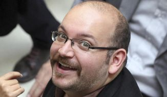 Jason Rezaian, an Iranian-American correspondent for the Washington Post, smiles as he attends a presidential campaign of President Hassan Rouhani in Tehran, Iran, April 11, 2013. (Associated Press) ** FILE **
