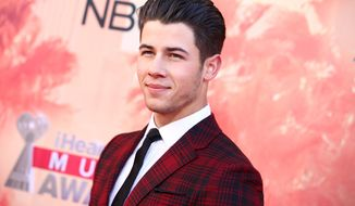 FILE - In a Sunday, March 29, 2015, file photo, Nick Jonas arrives at the iHeartRadio Music Awards at The Shrine Auditorium in Los Angeles. Billboard announced Tuesday, April 14, 2015, that Jonas, Sam Smith and Hozier will take the stage at the Billboard Music Awards on on May 17.(Photo by John Salangsang/Invision/AP, File)
