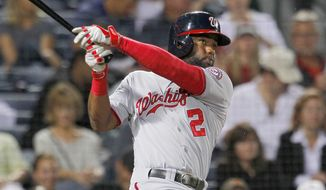 Washington Nationals center fielder Denard Span (2) hits a ball to right field to bring in a run in the third inning of a baseball game against the Atlanta Braves Monday, Sept. 15, 2014, in Atlanta. (AP Photo/Todd Kirkland)