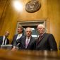 Senate Foreign Relations Committee Chairman Sen. Bob Corker, R-Tenn., center, speaks with the committee's ranking member Sen. Ben Cardin, D-Md., on Capitol Hill in Washington, Tuesday, April 14, 2015, as they arrive for a committee's meeting to debate and vote on the Iran Nuclear Agreement Review Act of 2015. Republican and Democrats on the Senate Foreign Relations Committee reached a compromise Tuesday on a bill that would give Congress a say on an emerging deal to curb Iran's nuclear program. Also pictured is Sen. Jeff Flake, R-Ariz., third from left. (AP Photo/Andrew Harnik)