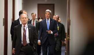 Secretary of State John Kerry arrives on Capitol Hill in Washington, Tuesday, April 14, 2015, for a House Democratic Caucus meeting to ask members of Congress to give the Obama administration more time and room to negotiate a final nuclear deal with Iran.Mr.  Kerry, who played a leading role in getting a framework agreement with Iran last month, personally pleaded with House Republicans and Democrats on Monday to give the Obama administration more time and room to negotiate a final deal. Kerry met in a closed-door session with members of the House and was to meet with senators on Tuesday before the committee debates the bill. (AP Photo/Andrew Harnik)