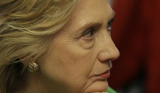 Democratic presidential candidate Hillary Rodham Clinton listens as she meets with local residents at the Jones St. Java House, Tuesday, April 14, 2015, in LeClaire, Iowa. (AP Photo/Charlie Neibergall)