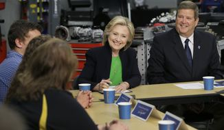Democratic presidential candidate Hillary Rodham Clinton, accompanied by Kirkwood Community College President Mick Starcevich, right, participates in a roundtable with educators and students at the Kirkwood Community College's Jones County Regional Center, Tuesday, April 14, 2015, in Monticello, Iowa. (AP Photo/Charlie Neibergall)