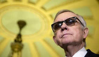 Senate Minority Leader Harry Reid of Nevada pauses during a news conference on Capitol Hill in Washington, Tuesday, April 14, 2015, following a Senate policy luncheon. (AP Photo/Manuel Balce Ceneta)