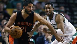 Toronto Raptors' Greivis Vasquez (21) drives past Boston Celtics' Evan Turner during the first quarter of an NBA basketball game in Boston, Tuesday, April 14, 2015. (AP Photo/Michael Dwyer)