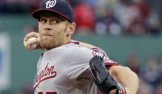Washington Nationals starting pitcher Stephen Strasburg delivers to the Boston Red Sox in the first inning of a baseball game at Fenway Park in Boston, Tuesday, April 14, 2015. (AP Photo/Elise Amendola)