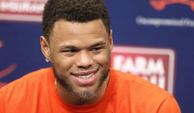 Virginia guard Justin Anderson answers questions during an NCAA college basketball news conference, Tuesday, April 14, 2015, in Charlottesville, Va., where he announced he planned to enter the NBA draft. (Ryan M. Kelly/The Daily Progress via AP)