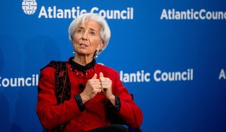 "In this Thursday, April 9, 2015 photo, International Monetary Fund Managing Director Christine Lagarde speaks at the Atlantic Council in Washington.  The IMF predicted Tuesday, April 14,  that the American economy will grow 3.1 percent this year and next, a performance the fund characterized as ""robust."" But the U.S. outlook was down from the IMF's January forecast of 3.6 percent growth in 2015 and 3.3 percent growth in 2016. The American economy advanced 2.4 percent last year.(AP Photo/Andrew Harnik)"