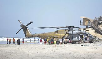 A Marine Corps helicopter sits in the sand where it made an emergency landing Wednesday, April 15, 2015 in Solana Beach, Calif.  The CH-53E Super Stallion landed on the shore of this northern San Diego County town shortly after 11:30 a.m. after a low oil-pressure indicator light went on in the cockpit, Marine Corps Air Station Miramar said in a statement. (AP Photo/Lenny Ignelzi) ** FILE **