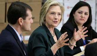 Democratic presidential candidate Hillary Rodham Clinton held a small-business roundtable Wednesday in Des Moines, Iowa, as part of her effort to show her more personal side, even as she eased away from President Obama's policies. (Associated Press) ** FILE **