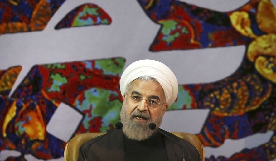 FILE - In this Sunday, April 12, 2015 file photo, Iranian President Hassan Rouhani speaks at a ceremony to commemorate the late Khadijeh Saghafi, wife of late revolutionary founder Ayatollah Khomeini, in Tehran, Iran. Rouhani has dismissed pressure from the U.S. Congress over a preliminary deal on Iran's nuclear program, saying that Tehran is dealing with world powers not American lawmakers. (AP Photo/Vahid Salemi, File)